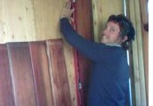 Customer installing their new redwood paneling